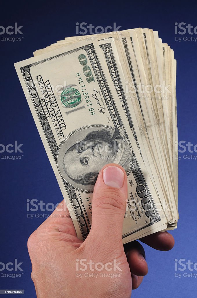 Money in the hand royalty-free stock photo