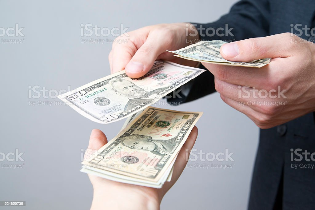 Money in the hands of the people stock photo