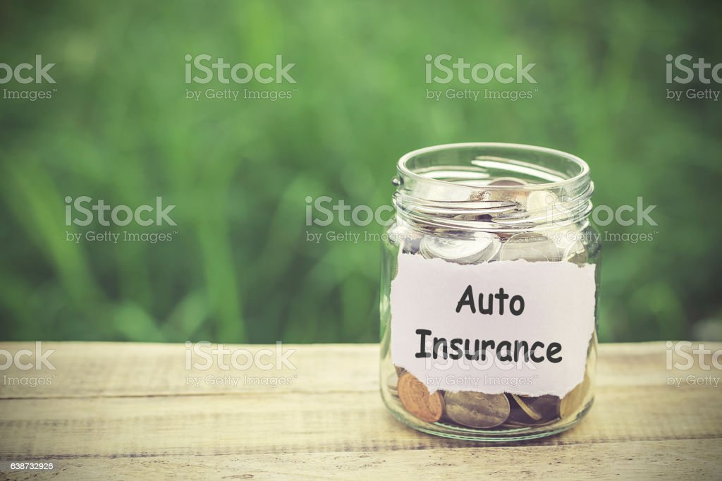 Money in the jar on wooden table stock photo