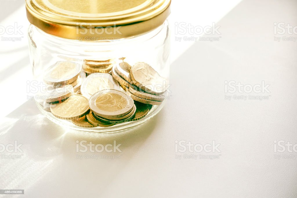money in the jar stock photo