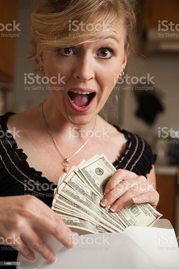 Money in the mail royalty-free stock photo