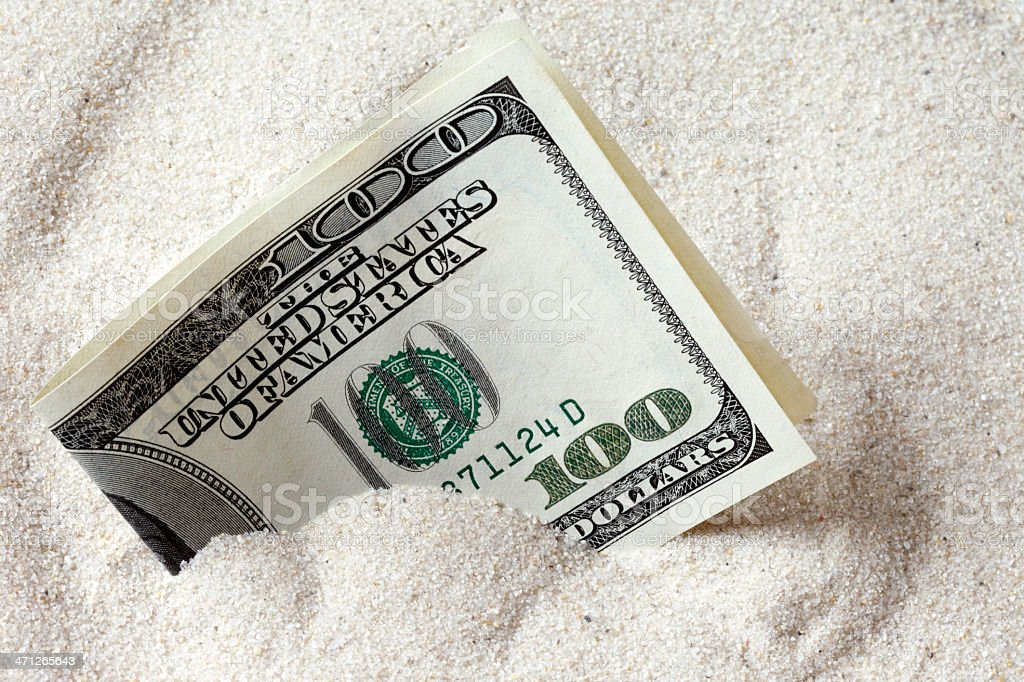 Money in the Sand stock photo