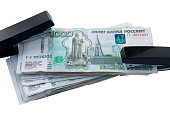 Money is fixed  both sides of  stapler. Ruble strengthening Concept