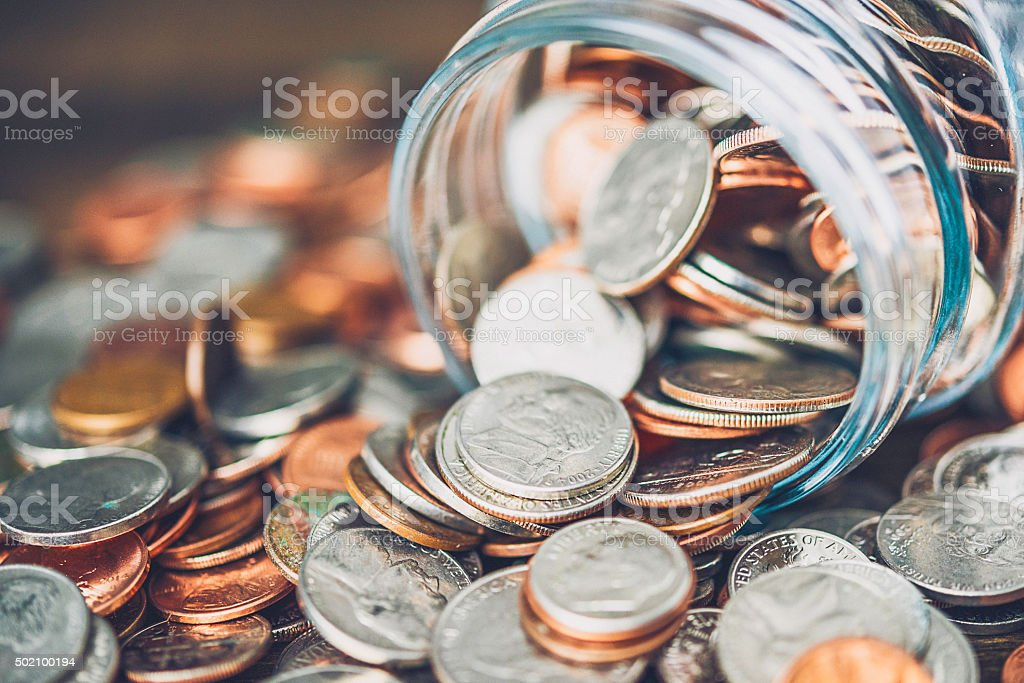 Money jar filled with American currency. Savings and donations concept. stock photo