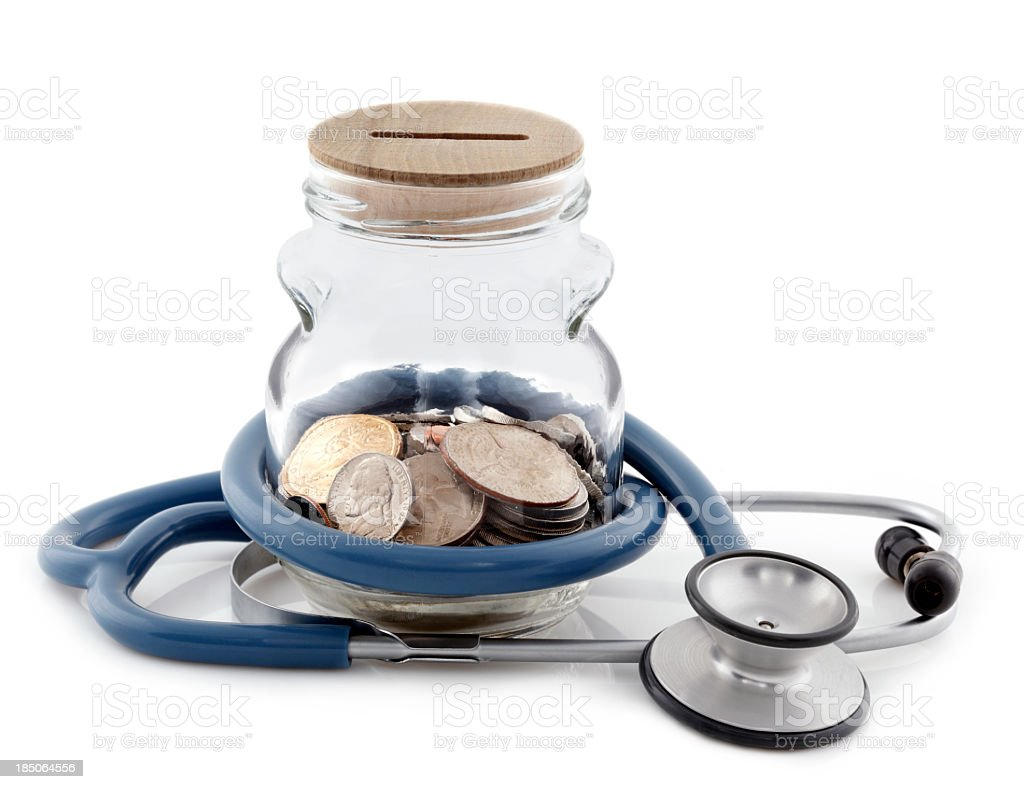 A money jar with a stethoscope wrapped around it isolated royalty-free stock photo