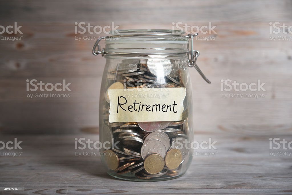 Money jar with retirement label. stock photo