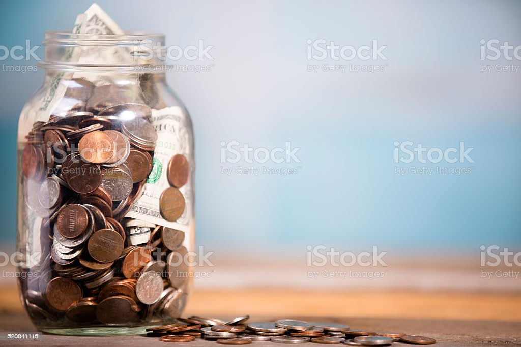 Money jar with U.S. currency.  Savings, donations concepts. stock photo