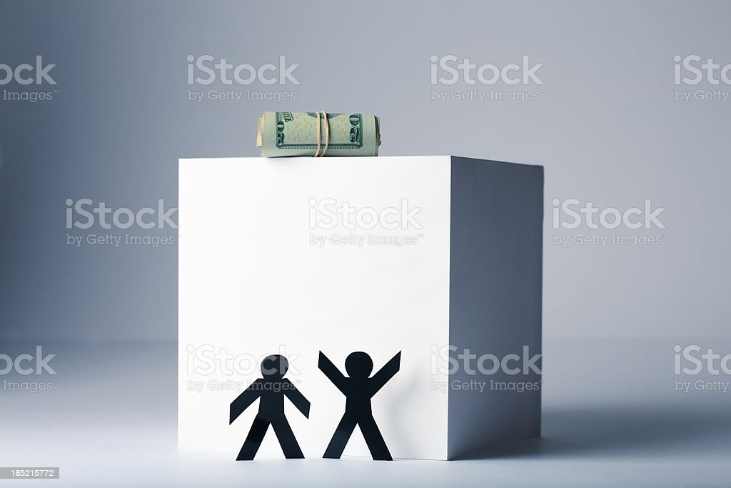 Money just out of reach - paper person conept stock photo