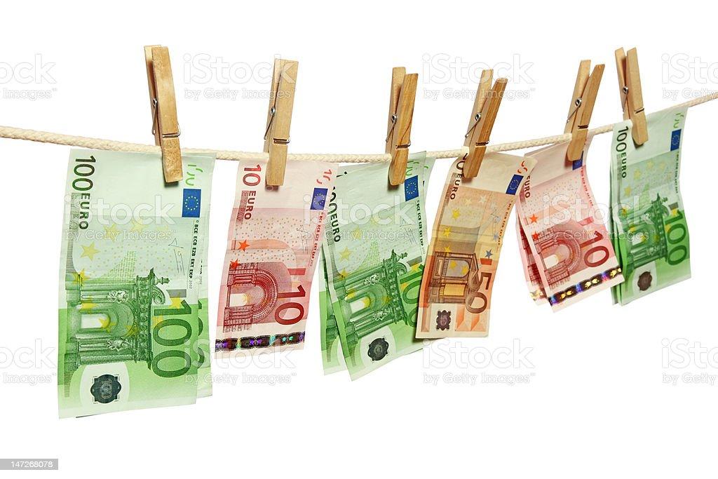 Money laundering on clothesline royalty-free stock photo