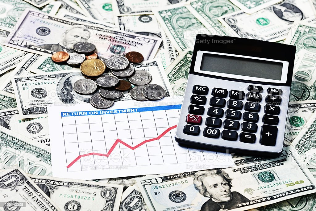 Money matters looking good: rising graph dollars and calculator royalty-free stock photo