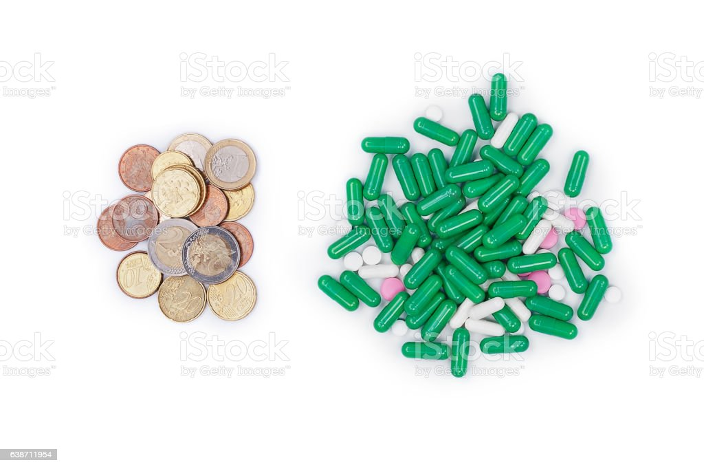 Money next with pills on white background stock photo