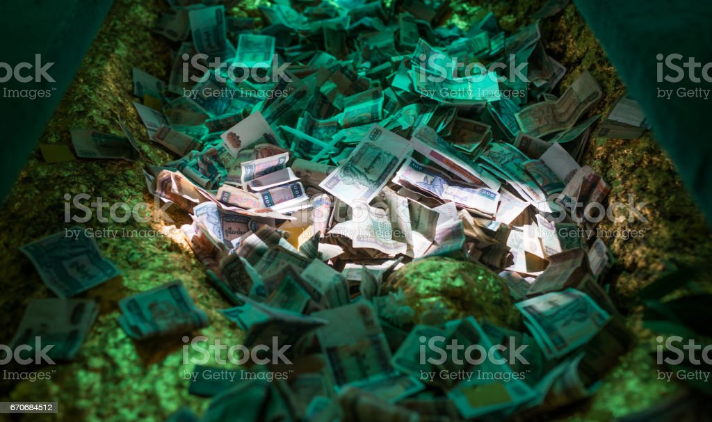 Money offered in Buddhist temple, Myanmar stock photo