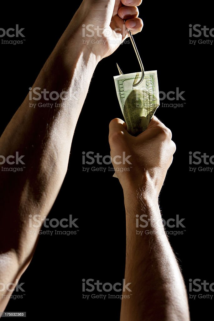 Money on the hook and human hands stock photo