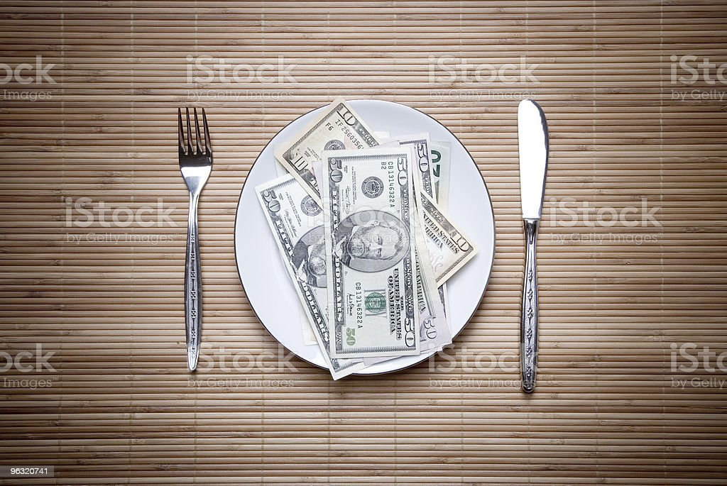 Money on the plate stock photo