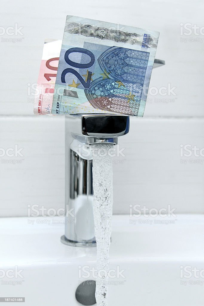 money on the tap with flowing water stock photo