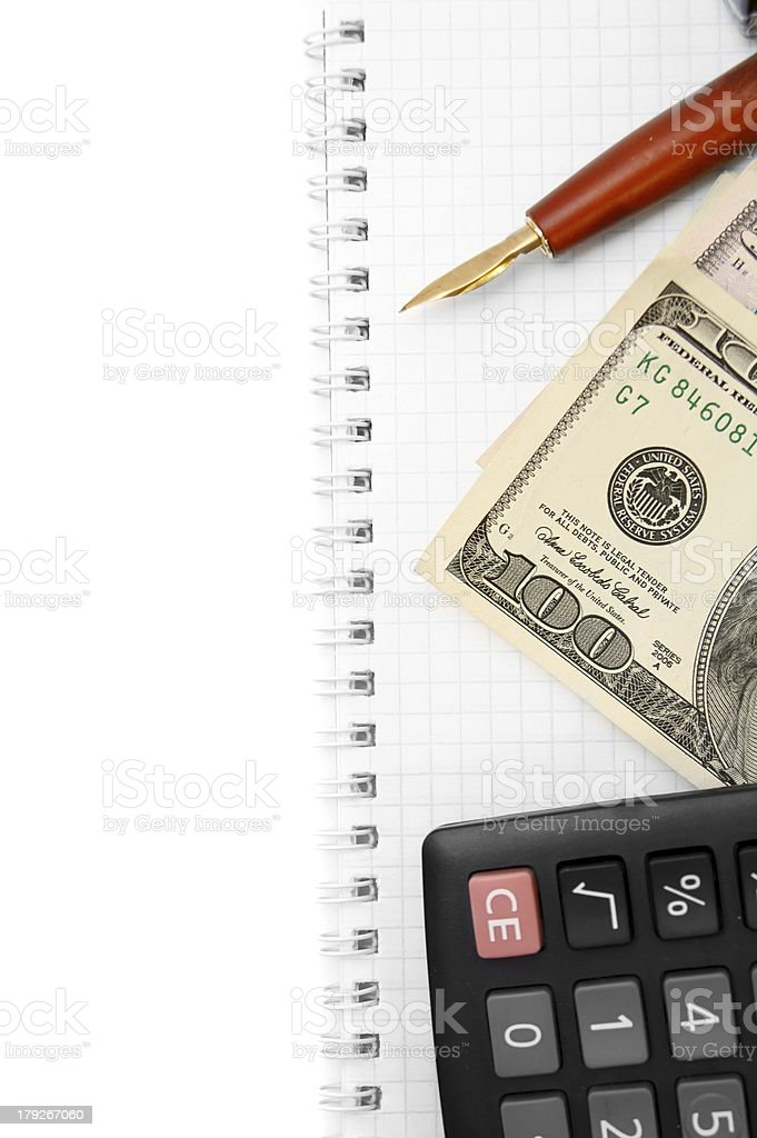 Money, pen, the calculator on a notebook. royalty-free stock photo