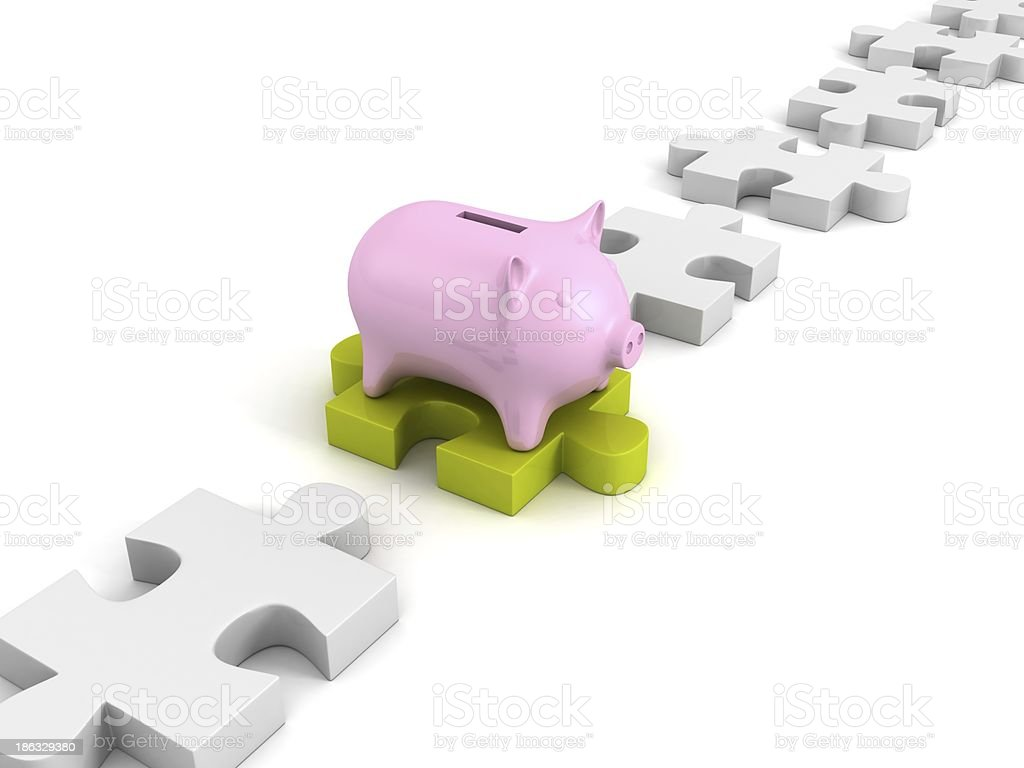 money piggy bank on green jigsaw puzzle in row royalty-free stock photo