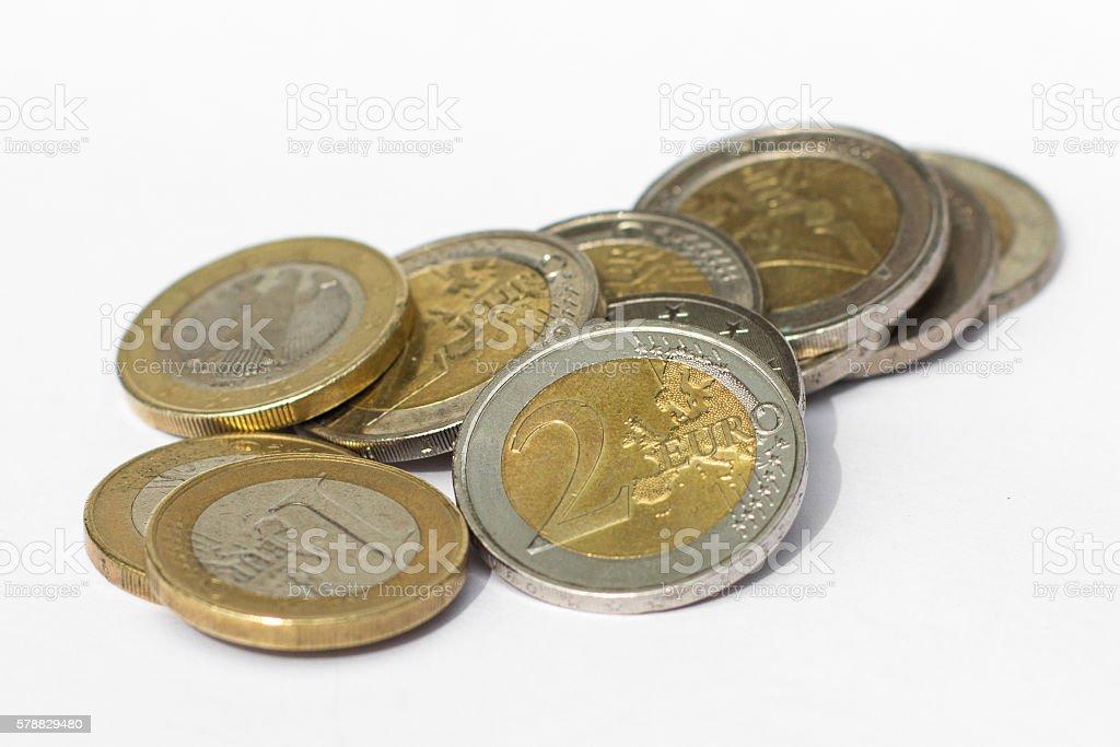money - pile of euro coins on white background stock photo