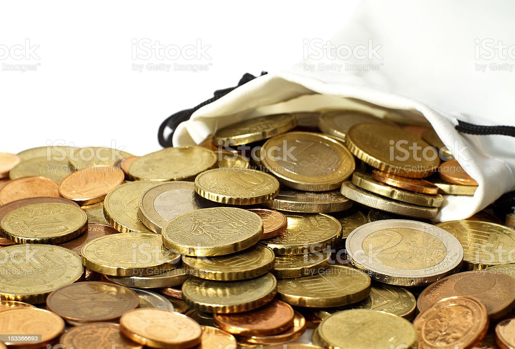 Money Pouch of Euro coins spilled out on a table stock photo