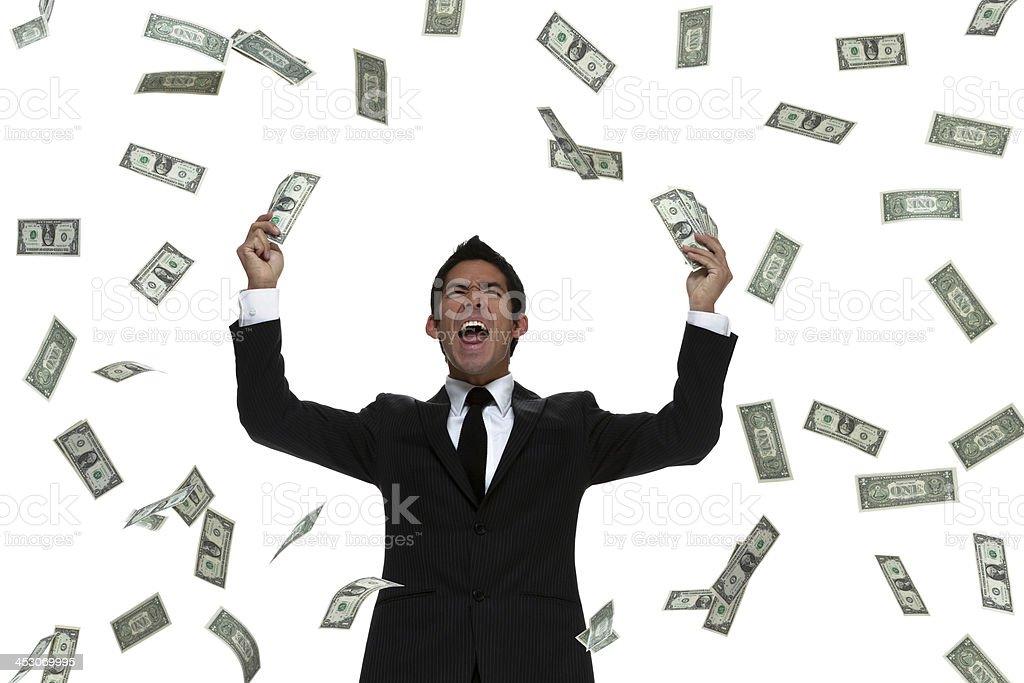 money raining on a celebrating business man stock photo