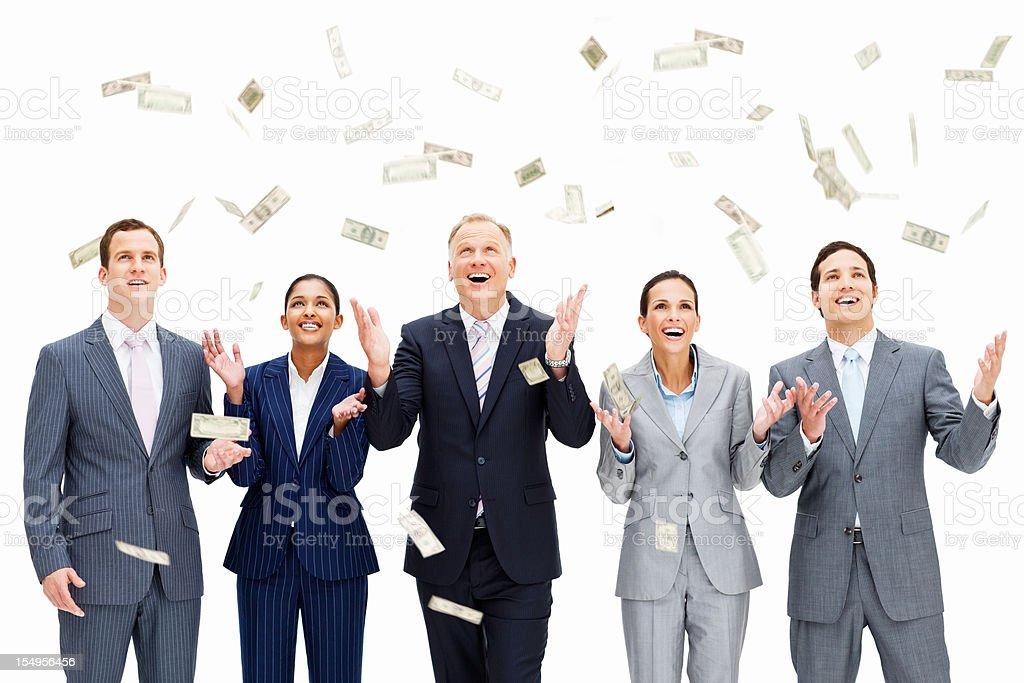 Money Raining On Smiling Businesspeople stock photo