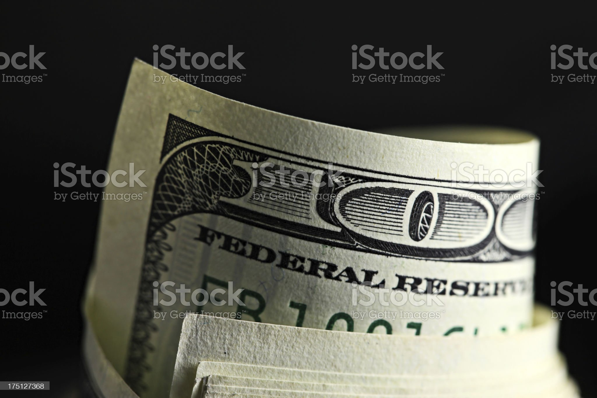 Money roll with US dollars royalty-free stock photo