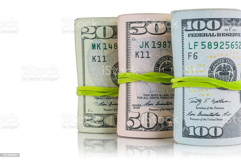 Money rolls to spend stock photo