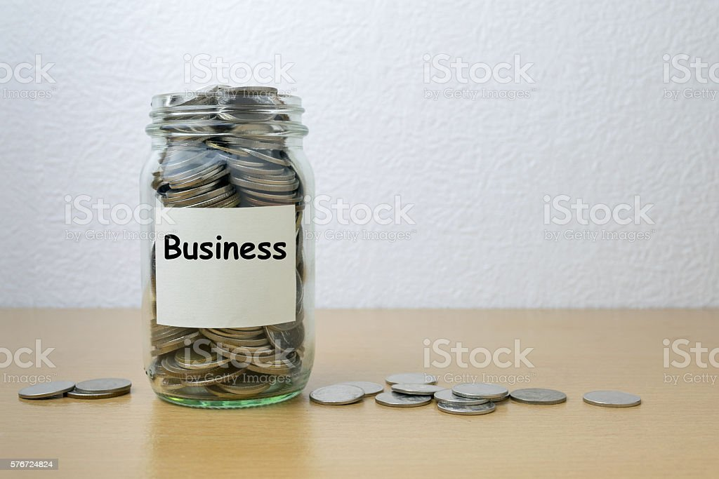 Money saving for business in the glass bottle stock photo