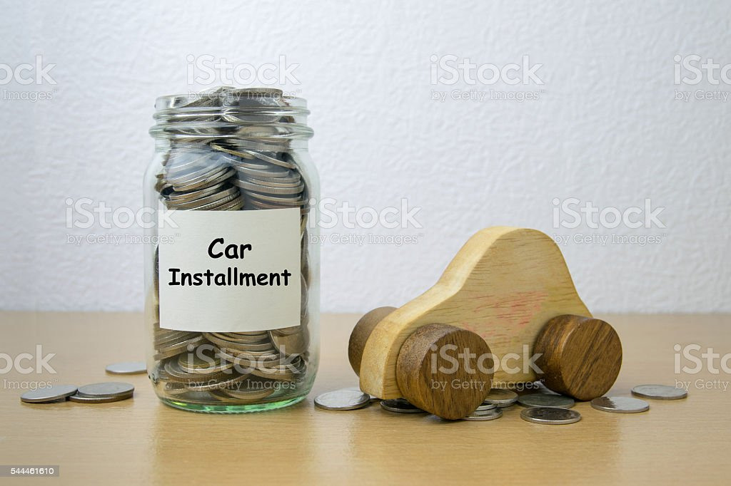 Money saving for Car installment in the glass bottle stock photo