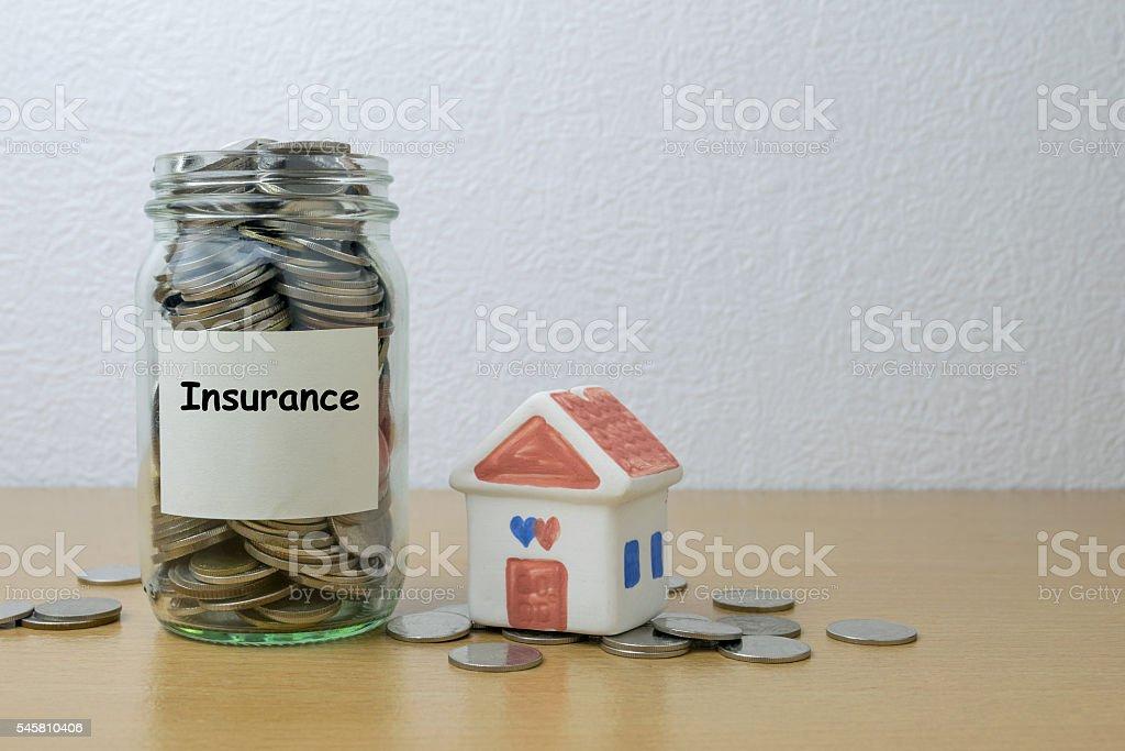 Money saving for Insurance in the glass bottle stock photo