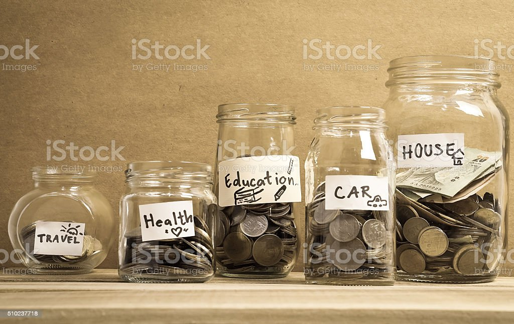 money saving in the glass bottle for money concept stock photo