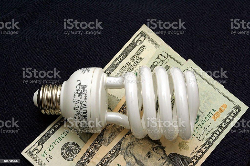 Money saving light bulb stock photo