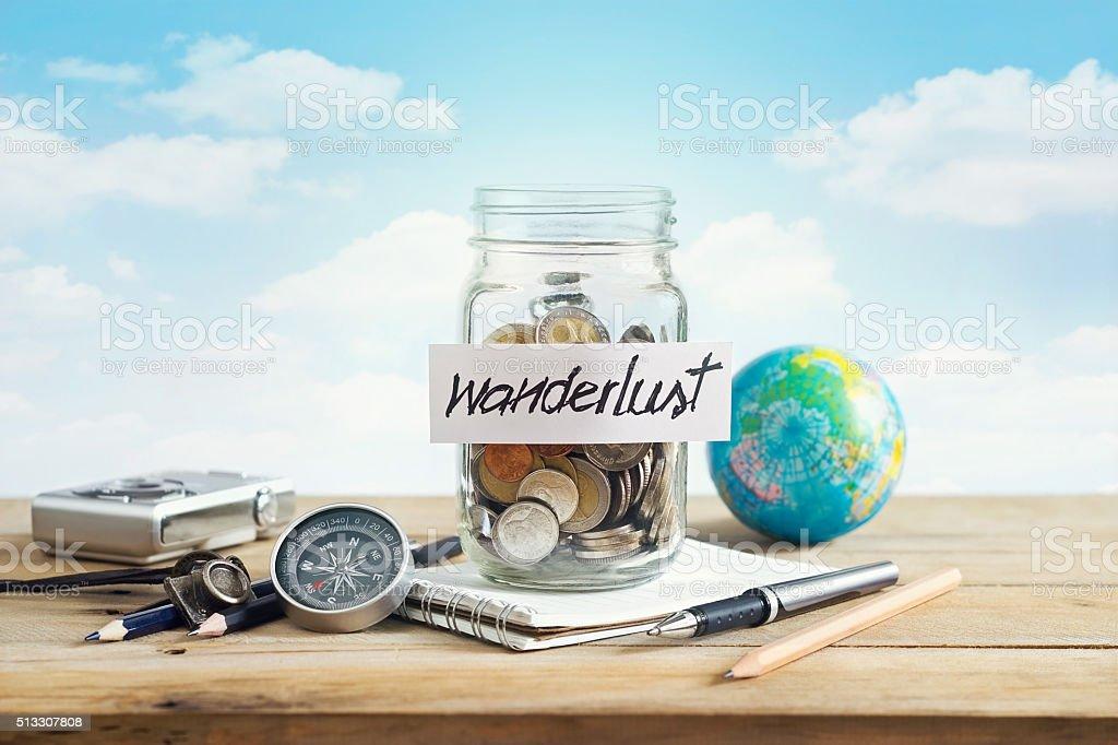 Money savings in a glass jar on blue sky background stock photo