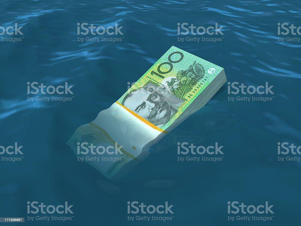 Money sinking in water. Australian Dollars stock photo