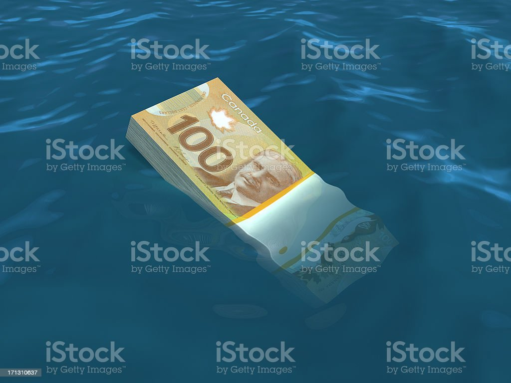 Money sinking in water stock photo