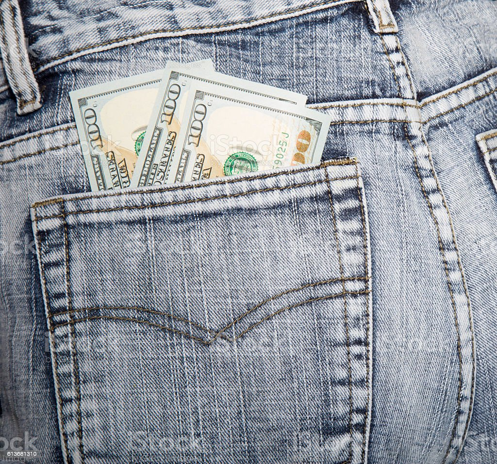 Money, some notes on hundred dollars, in a hip-pocket stock photo