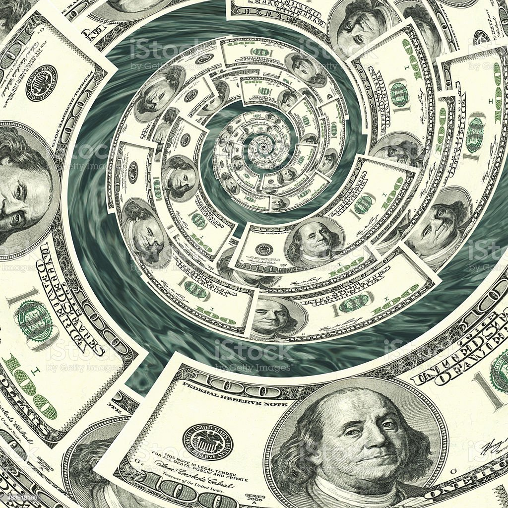Money spinning down a drain via a spiral stock photo