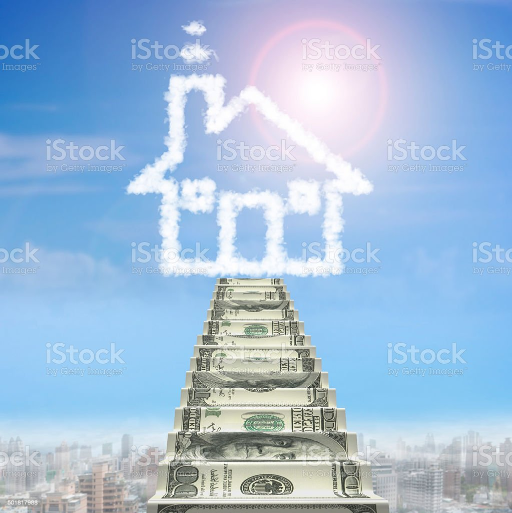 Money stairs toward house shape white cloud stock photo