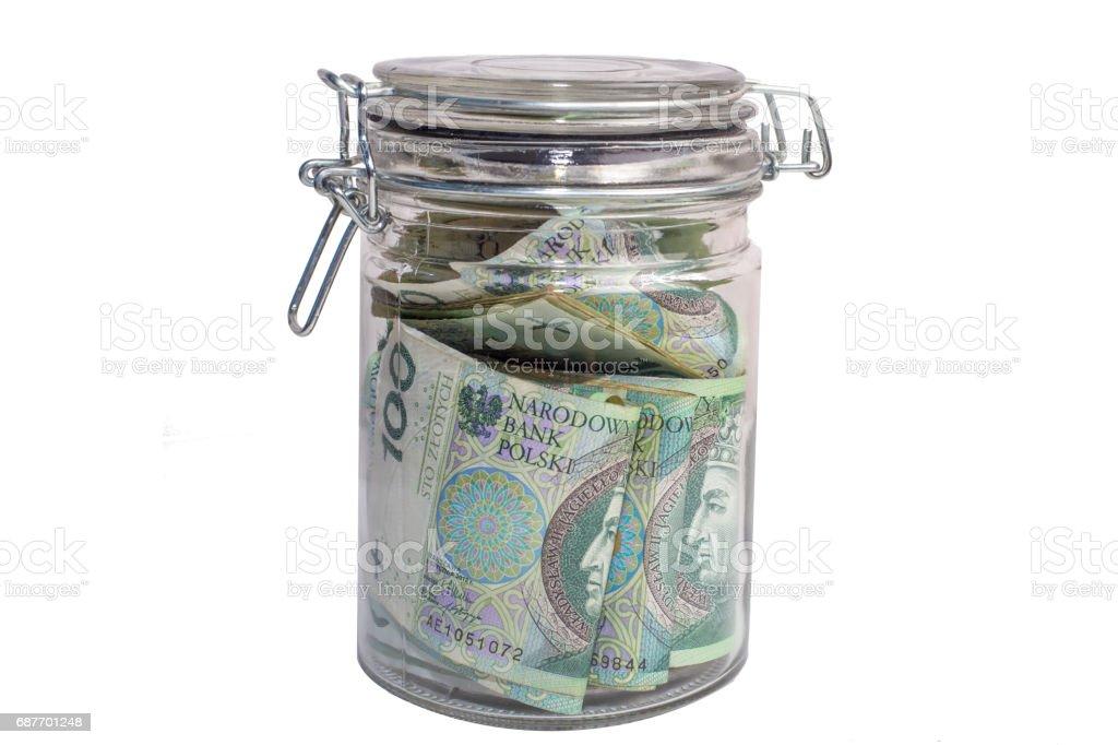 Money stored in a sealed retro jar. Polish Zloty stock photo