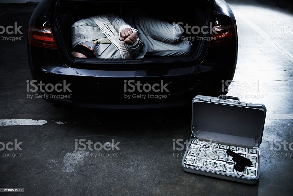 Money through violence stock photo