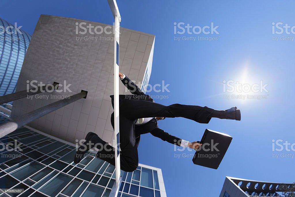 money transfer - businessman over hurdle royalty-free stock photo