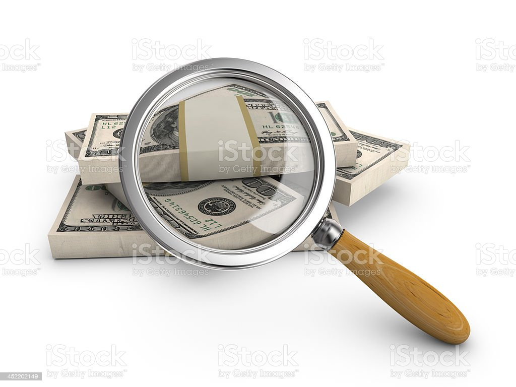 Money under a magnifying glass. royalty-free stock photo