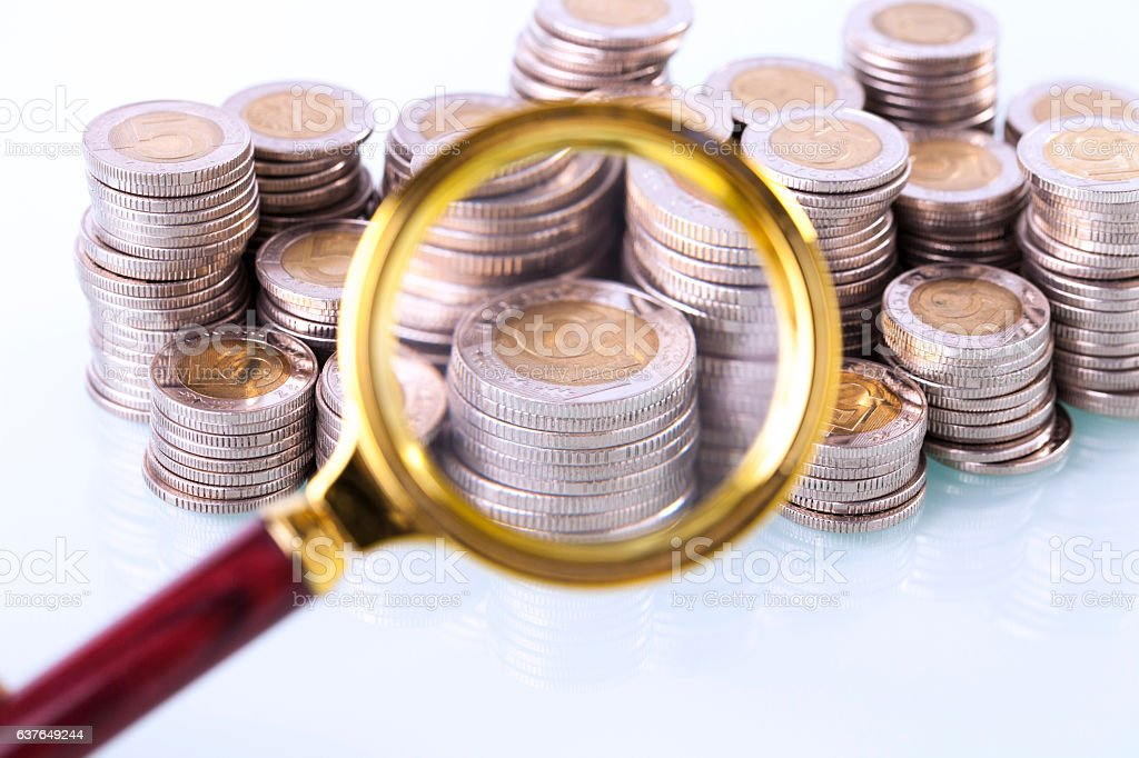 Money under loupe. Zoom on home finances stock photo