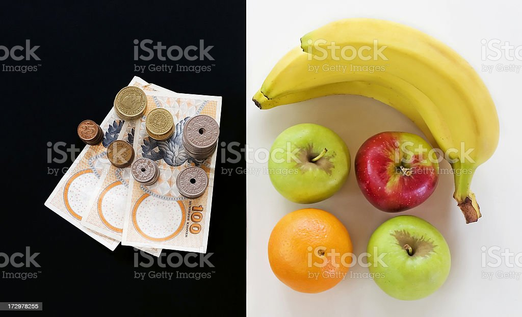 Money Vs. healthy food stock photo