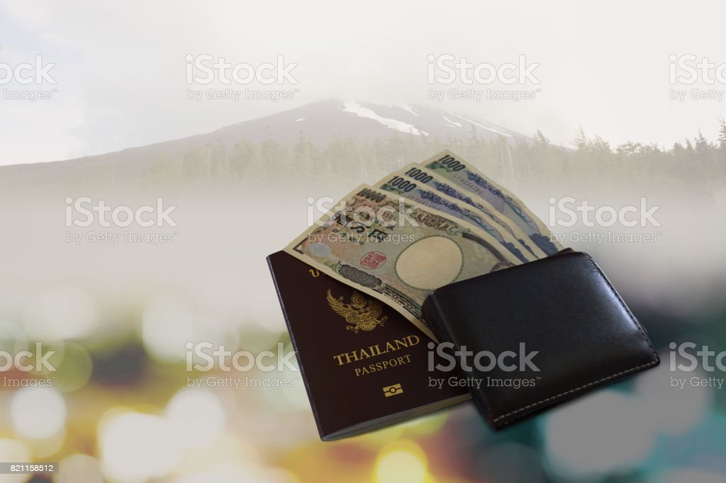 Money yen in wallet black with backgrounds mount fuji stock photo