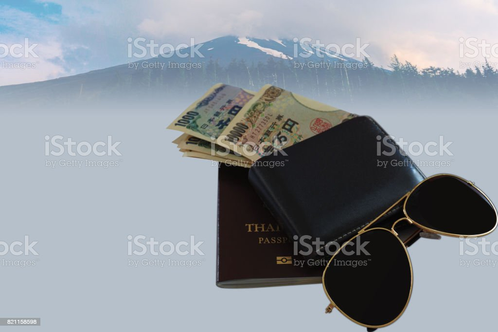 Money yen in wallet passport glasses with backgrounds stock photo