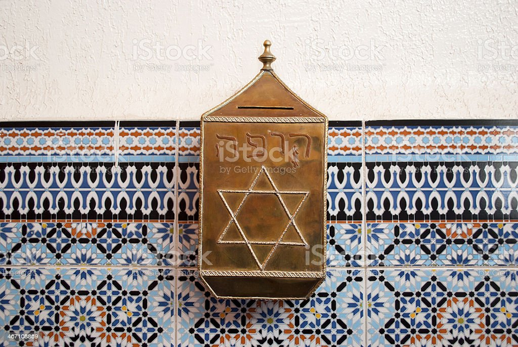 Moneybox in the synagogue of Marrakech stock photo