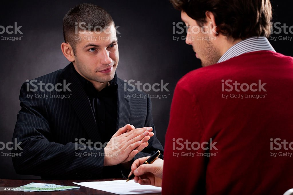 Moneylender talking with client stock photo