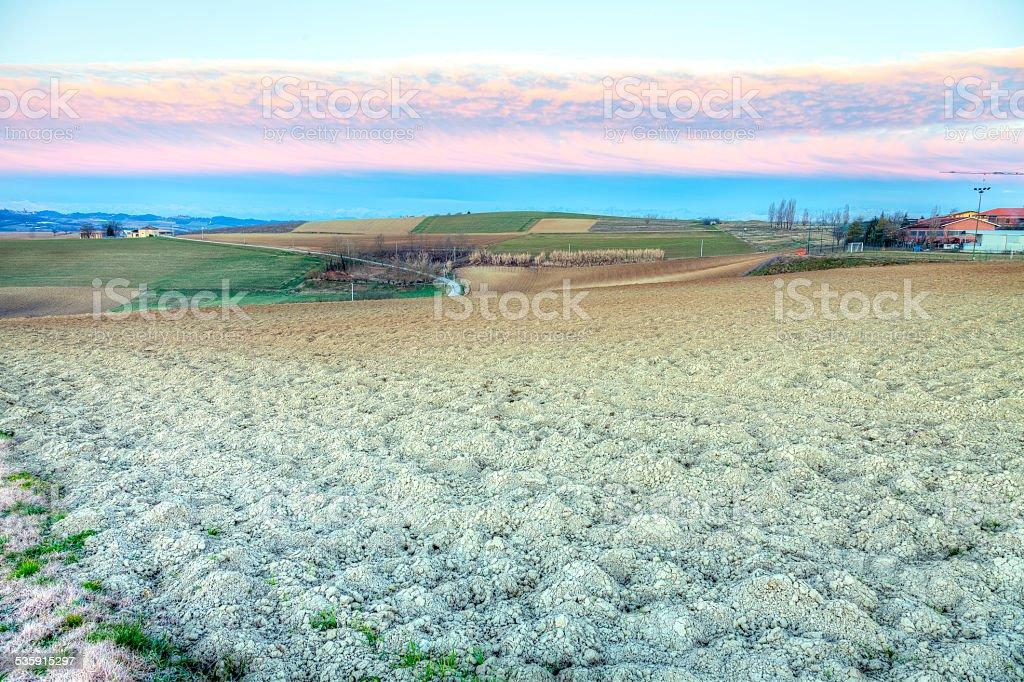 Monferrato, countryside fallow field, winter sunrise. Color image stock photo