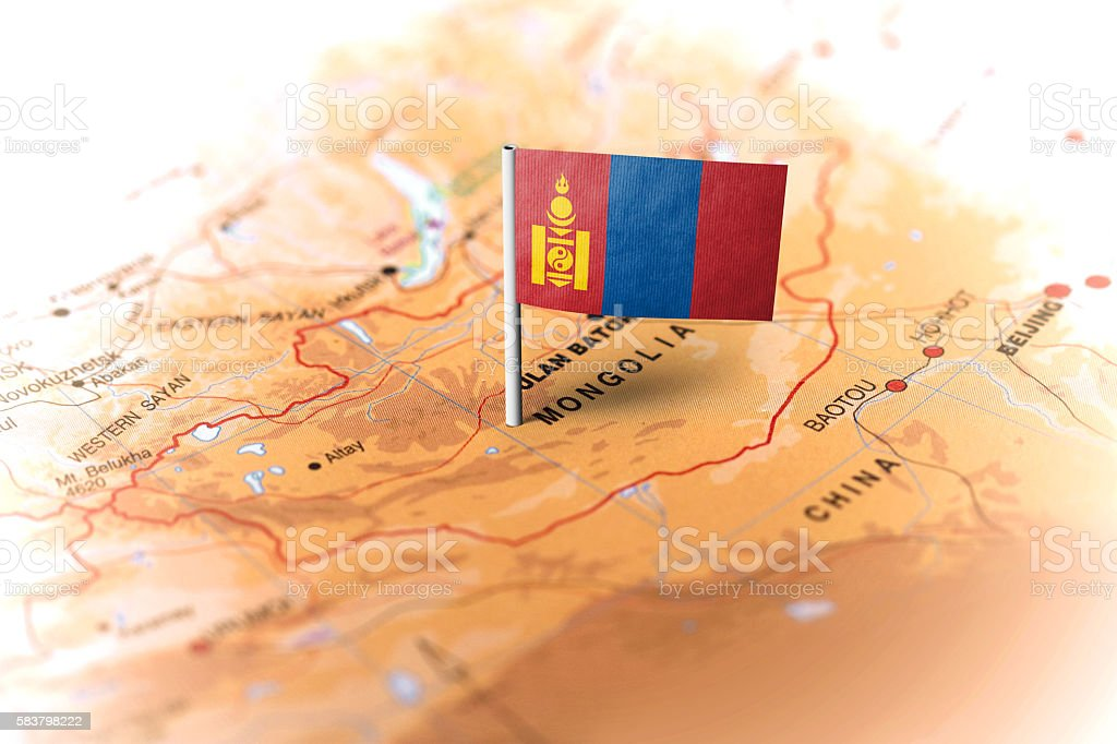 Mongolia pinned on the map with flag stock photo